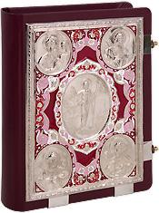 Евангелие напрестольное в кожаном переплете с никелированными накладками с росписью.