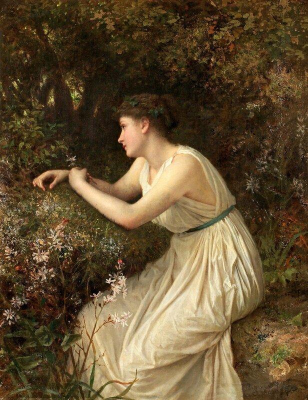 Молодая женщина в лесу.